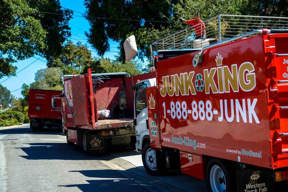 3 junk king truck travelling on Boston Road