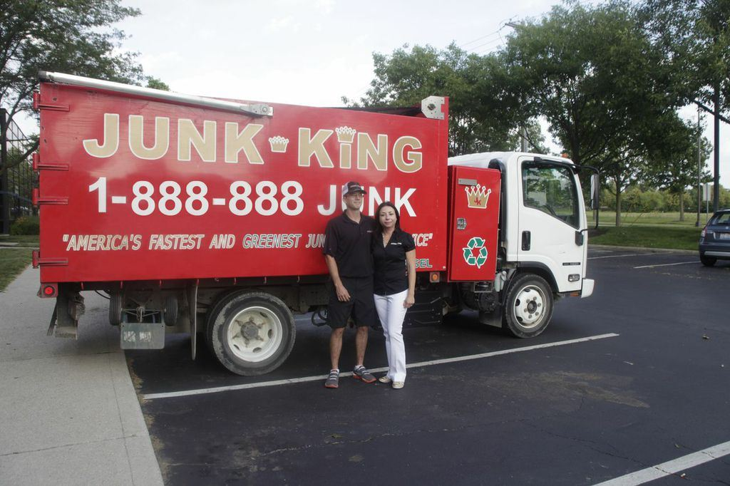 Junk King Franchise Owners,  Erik and Marta Hughes.