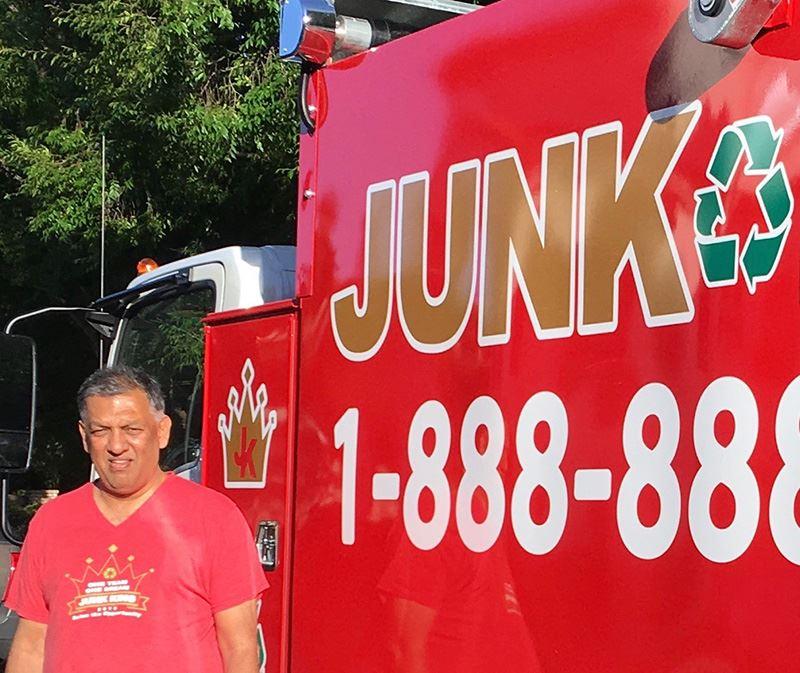 Junk king worer alongside junk king truck