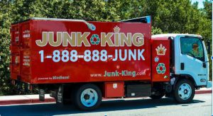 "Red Garbage Truck with Words'Junk King' and numbers ""888 888"