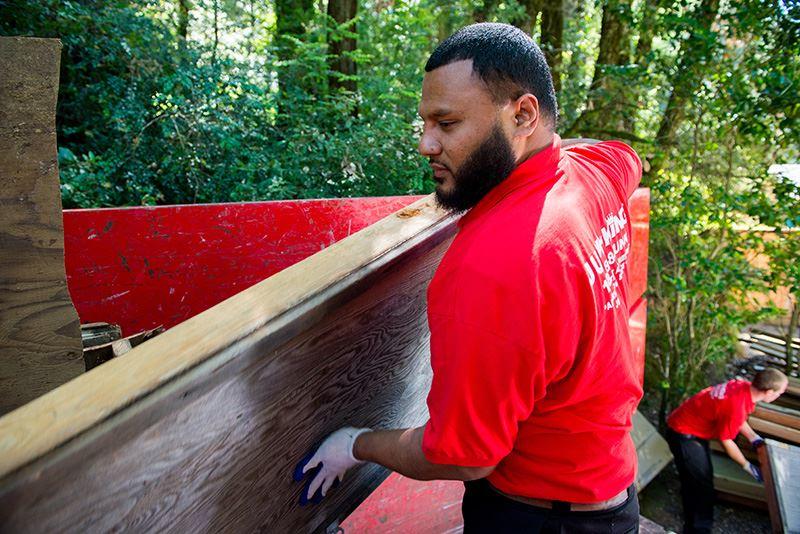 Junk King worker loading junk and debris