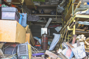 old boxes junk and equipment scattered inside a garage