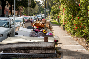 old matress and furniture outside on curb