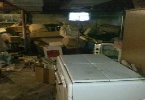 old fridge, boxes and debris