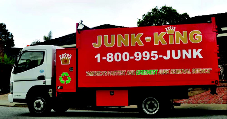 Red Junk King Truck parked in front home