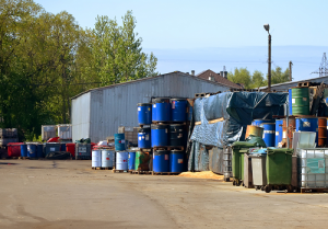 Chemical Waste in barrels outside building