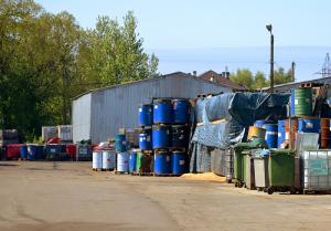 Chemical Waste in barrels outside building