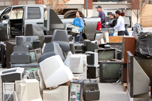 People offloading Televisions at a Recycling Center