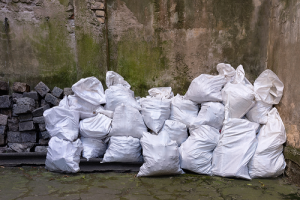 Piles of Garbage in White Bags