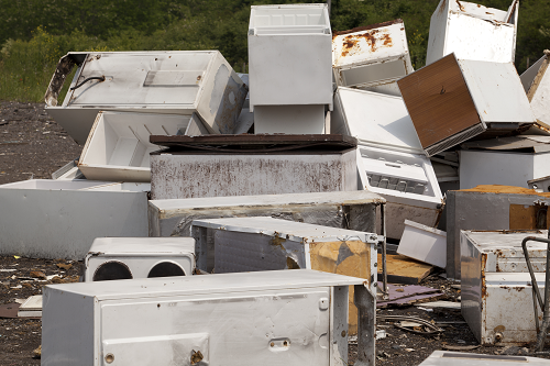 Pile of old white appliances