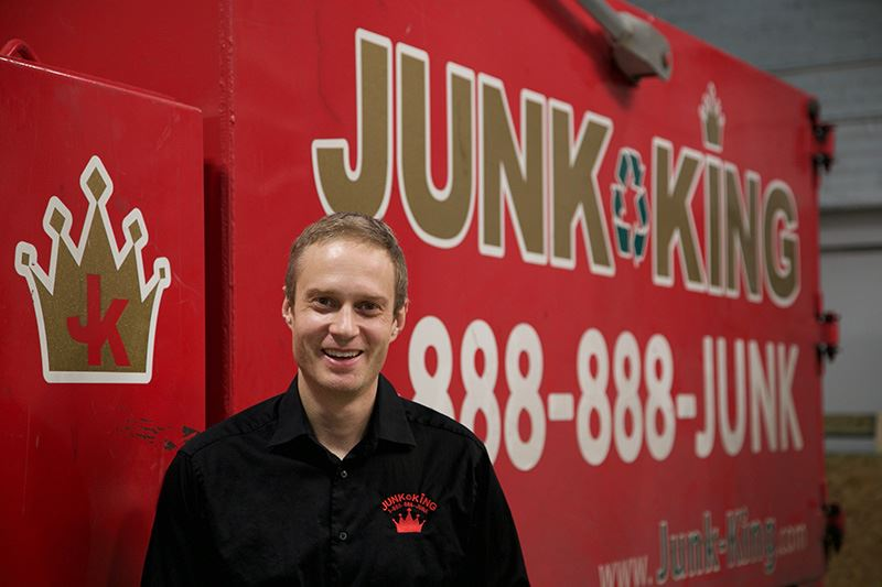 Junk King Franchise Owner,Carlos and Vanessa Duenas.